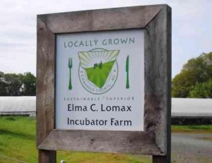 The Lomax Incubator Farm sign shows the Cabarrus Grown logo that producers can use to promote their products grown in Cabarrus county.